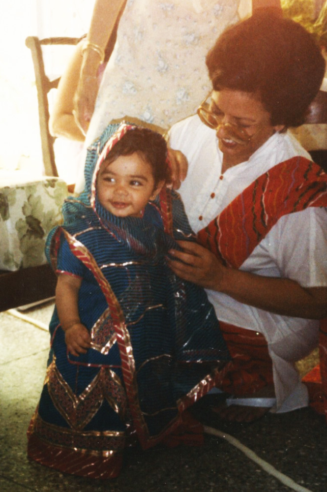 (My Bua (aunt) and I, again in India, on my 1st birthday)