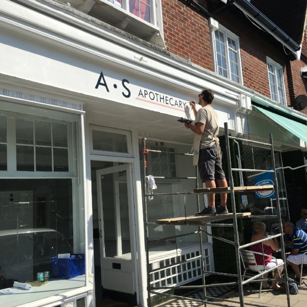 Keith Pettit painting the name above our new shop
