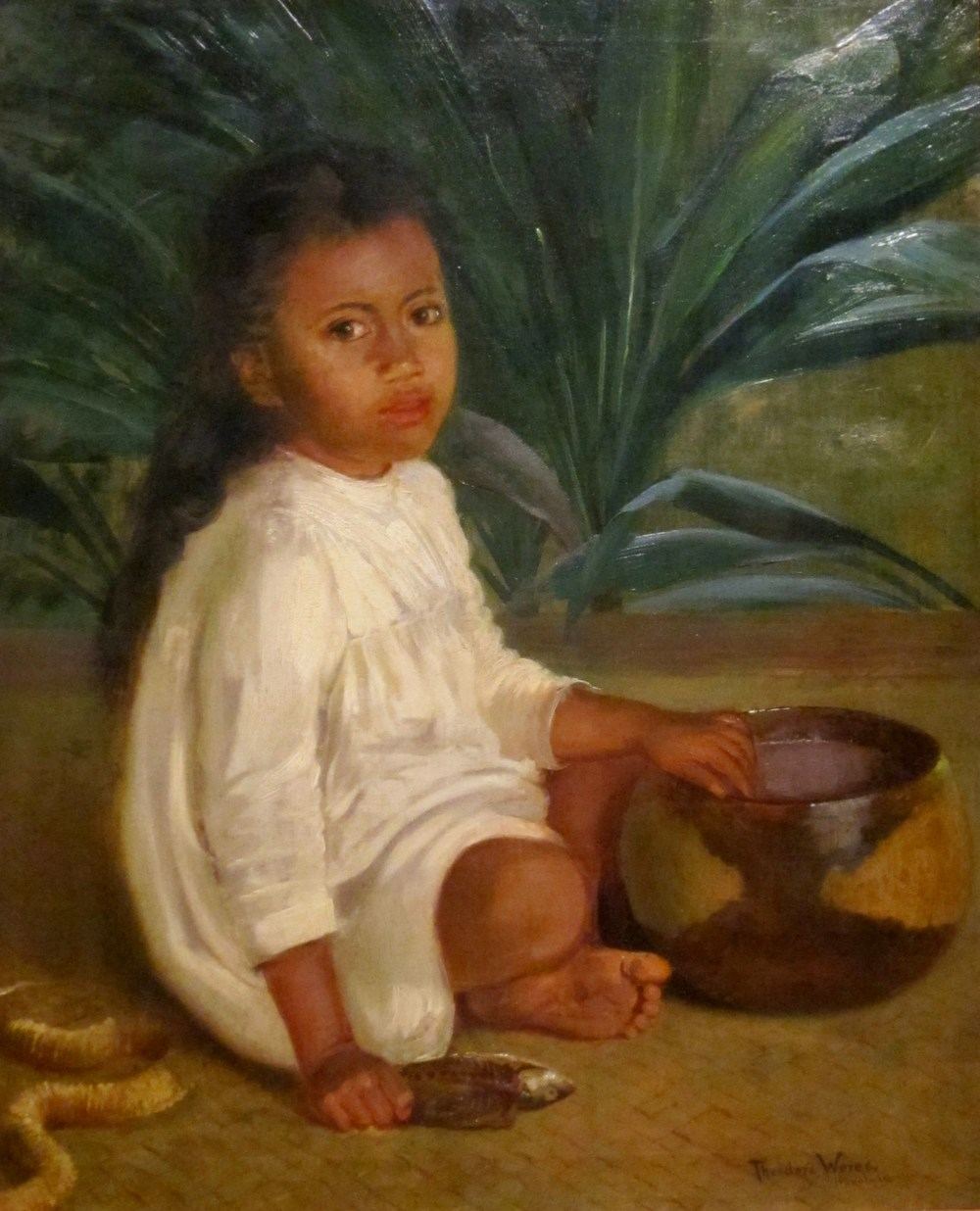 Young Hawaiian girl eating poi