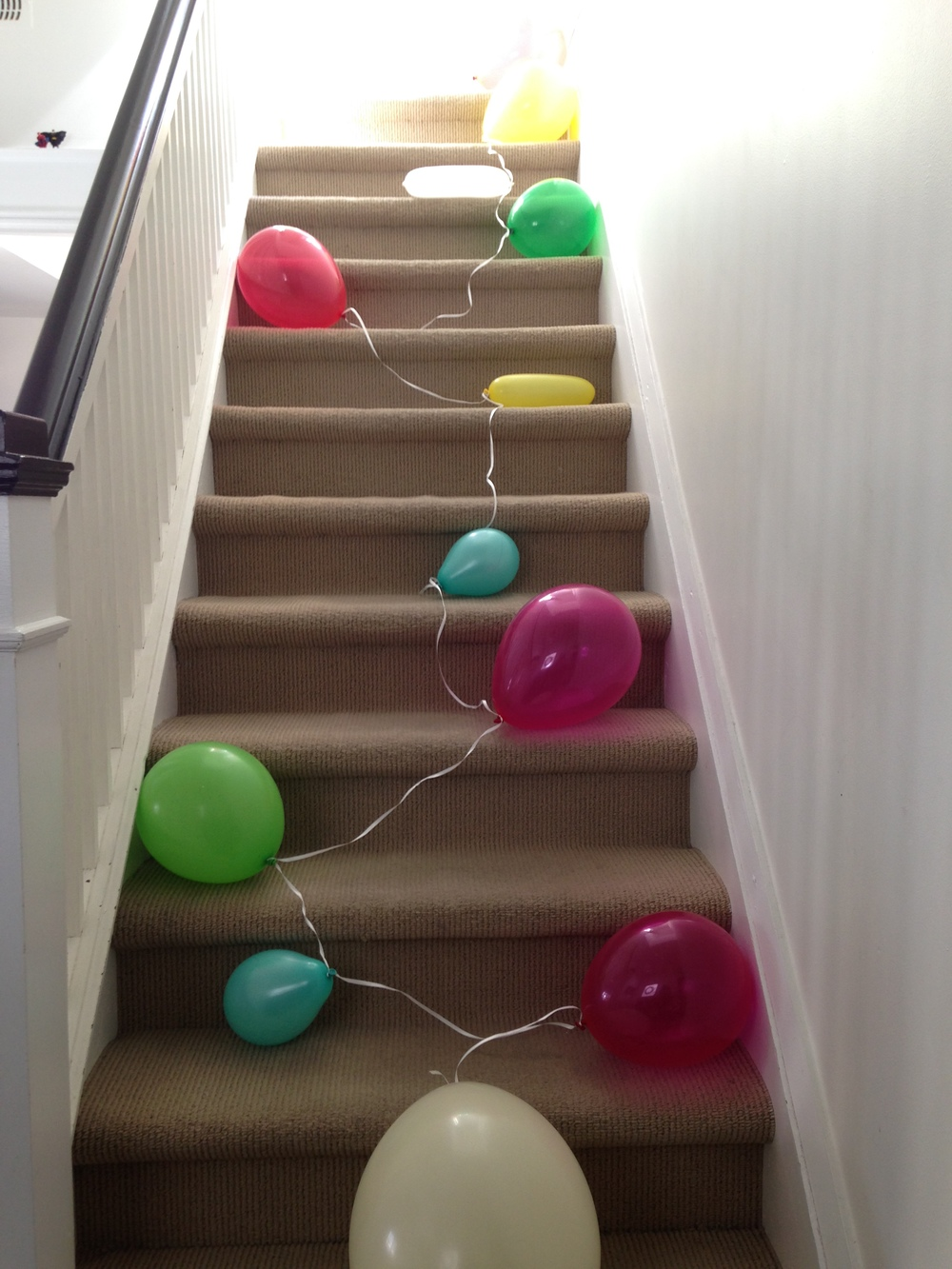 Follow the string of rainbow balloons =)