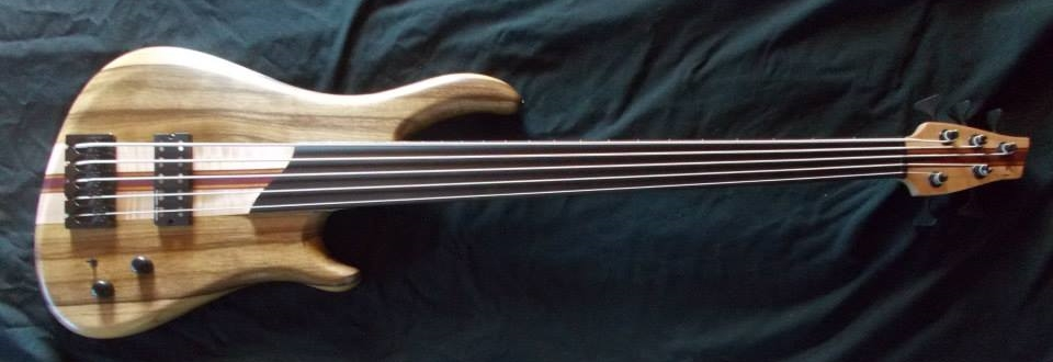 "Brian's 5 string fretless. 35"" scale with maple,purpleheart neck. The absolute blackest of black ebony fingerboard. Black Limba body. One single Duncan NYC humbucker in the sweet spot and passive controls."