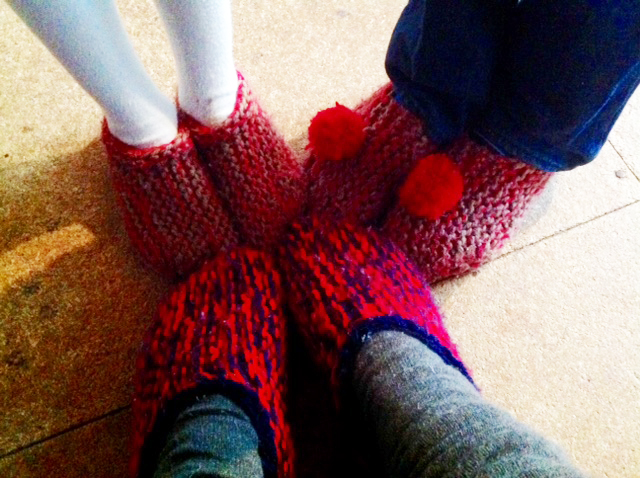 The kids and I in our Ces Slippers. Other designs use two pairs of old socks stitched together, with cardboard between the layers on the soles...