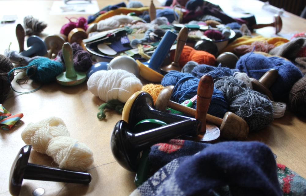 Mending mushrooms and yarns galore, tactile and colorful tools to get us darning, supplied by Tom. (We supplied the moth-eaten woollens)