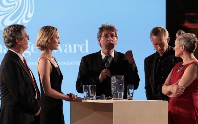 The judging panel in conversation on stage at Stockholm City Hall, from left: Ellis Rubenstein, CEO of New York Academy of Sciences; Amber Valetta, entrepreneur and activist; Professor Michael Braungart, co-author of Cradle-to-Cradle; Professor Johan Rockstrom, Stockholm Resilience Centre; and me...