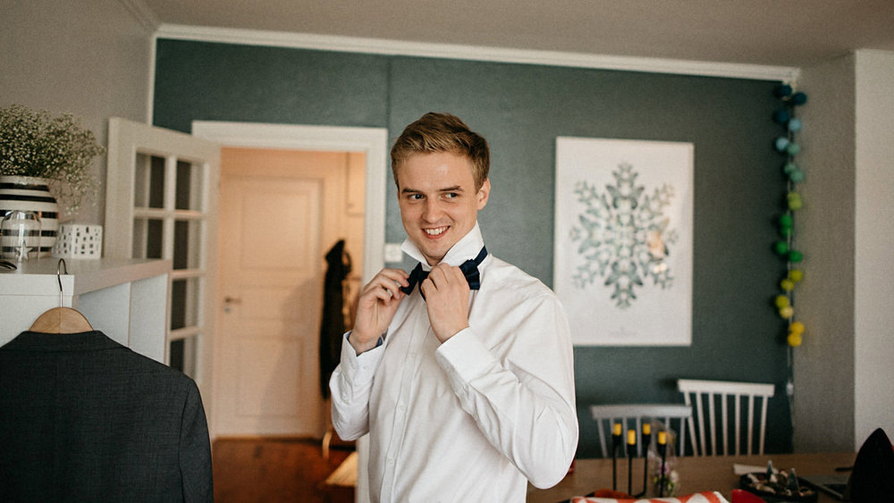 Groom getting ready at home