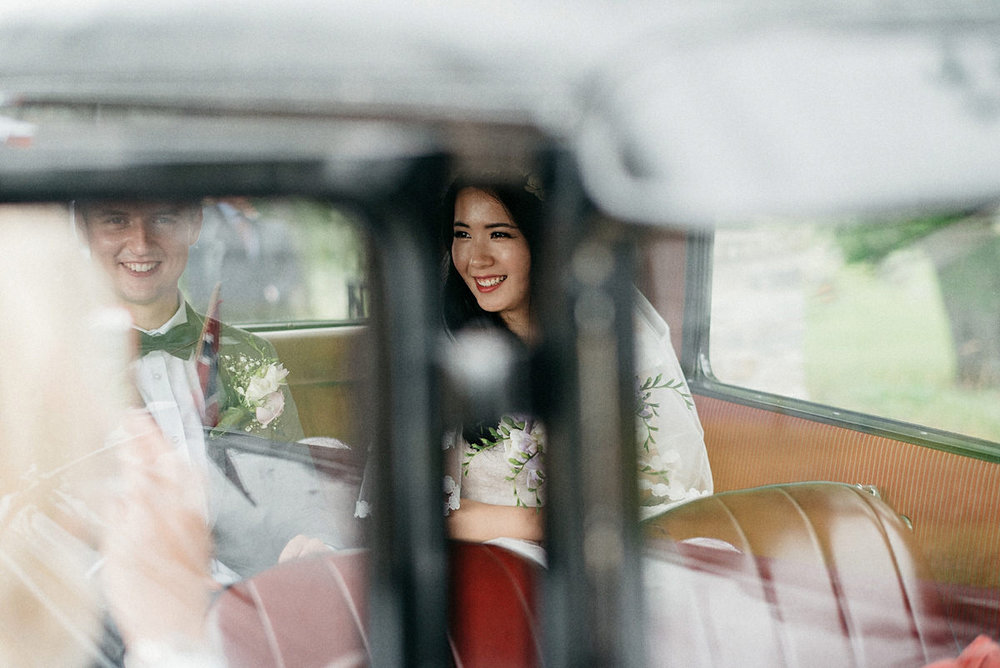 Wedding couple in their ride