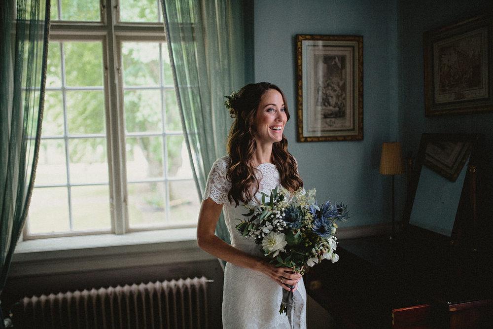 Joyful bride in her wedding dress