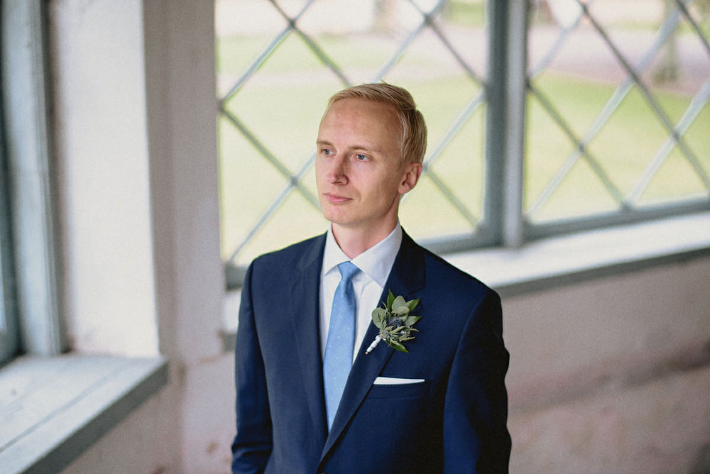 Groom portrait by a window