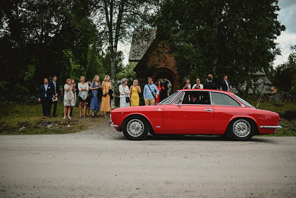 Red car wedding ride