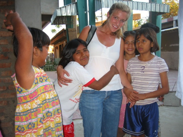 A volunteer playing with girls at the orphanage.