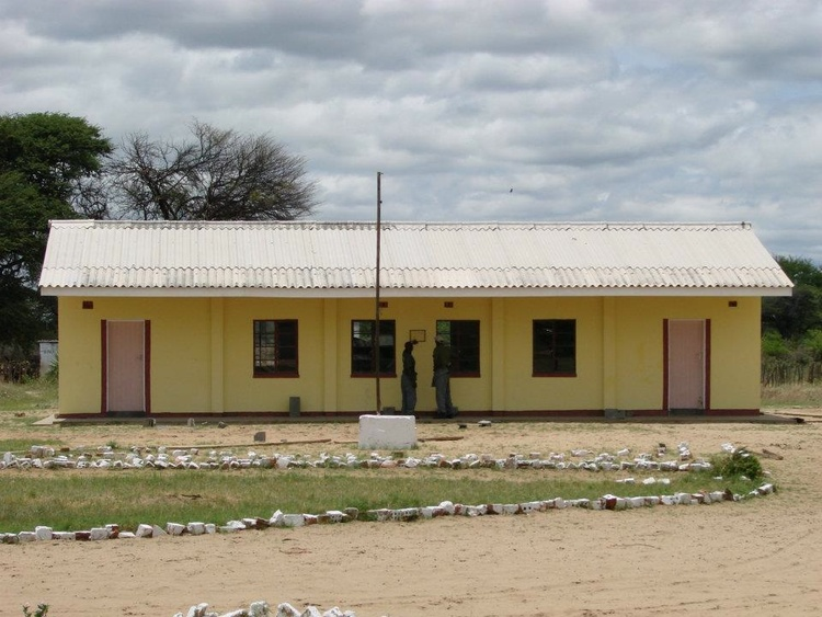 Ngamo Secondary School block after completion.  Materials for construction include brick, stone, black sheeting, 26 loads of river sand, 7 loads of quarry, brick moulding, cement, window frames, air vents, trusses, wire nails, steel door frames, and paint.