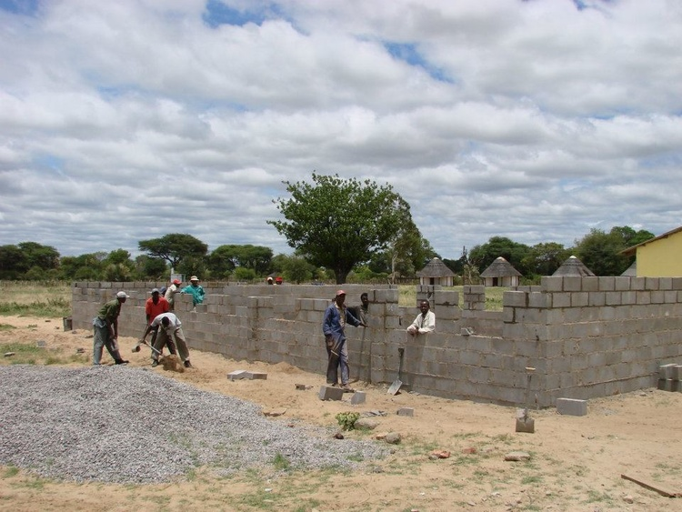 New construction on a classroom block.  Local villagers are employed for the work.