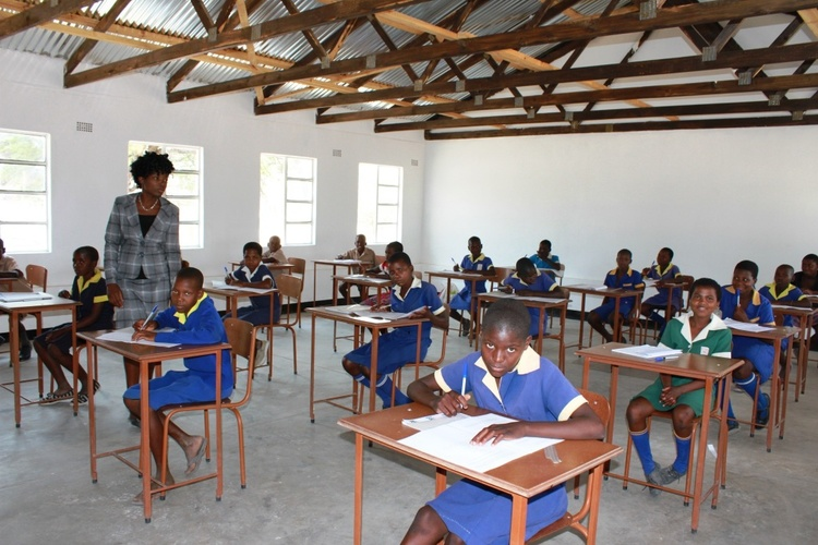 Grade 7 Girls writing exams in their new classroom.