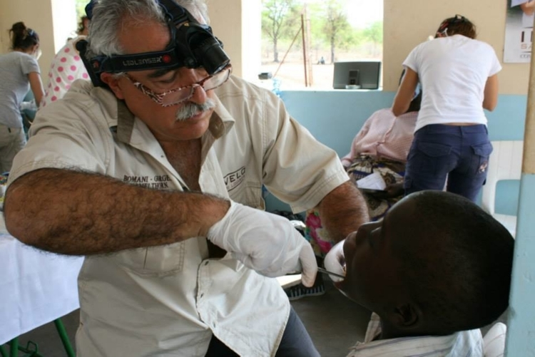 Paco works on a youngster at SIdenda Clinic.