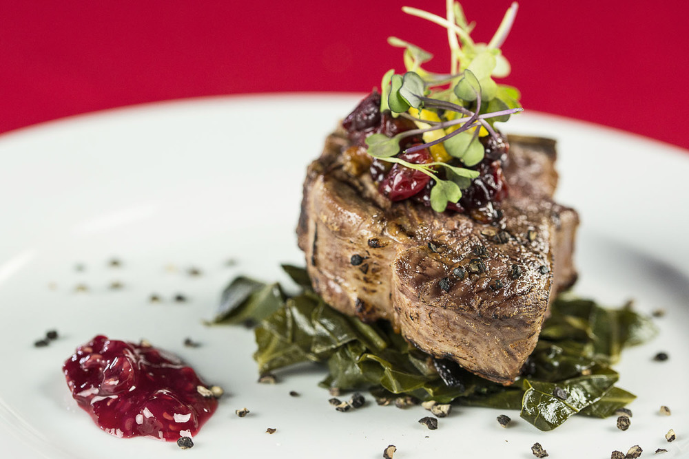 Seared Lamb Chop, slow cooked greens, cranberry jam