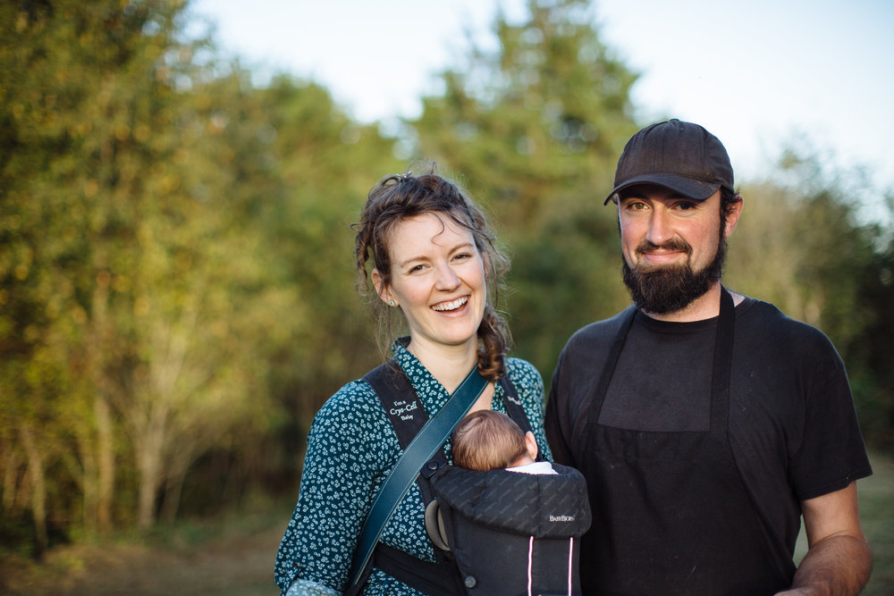 Erin, two-week old Daphne, and Jeremy at their annual Harvest Moon Dinner hosted on the farm, 2016