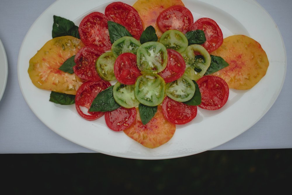 Staying out of the way of good ingredients, this simple heirloom tomato and basil salad was harvested right here in the Driftless Region