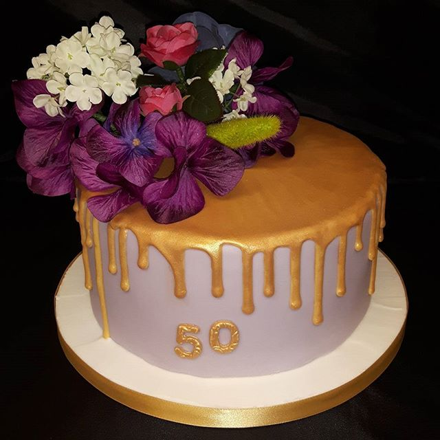 Floral Drip Cake #50thbirthday #flowers #50th #dripcake #birthdaycake #celebrationcakes ##peartreecakeco #peartreecakesshirley
