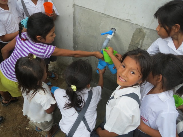 Among the things I've seen in the service projects I've visited, this is one of my favorites: children in the Peruvian Amazon taking their first sips ever of clean, filtered water.  The project was run by the nonprofit group CONAPAC.