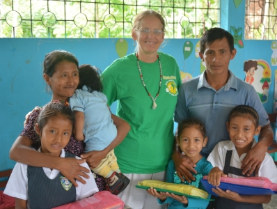 Pam Bucur and an Adopt-A-School family