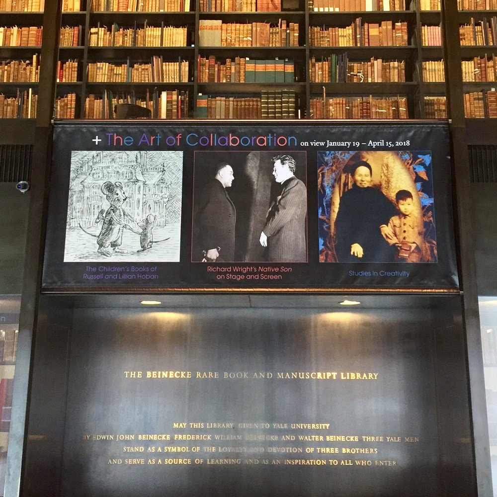 +Art of Collaboration banner in the lobby featuring artwork based on my father's archive (right).
