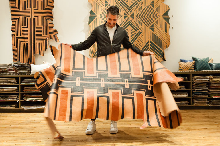 The textile designer Zak Profera with the Painted Plains Bold Hide by AVO, at Studio Four NYC. Credit: Robert Wright for The New York Times