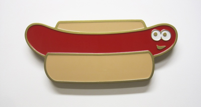 "Happy Hot Dog by Jay Kaplan | MDF, Enamel, Vinyl, Resin | 16"" x 6.75"" (available individually or as installations)"