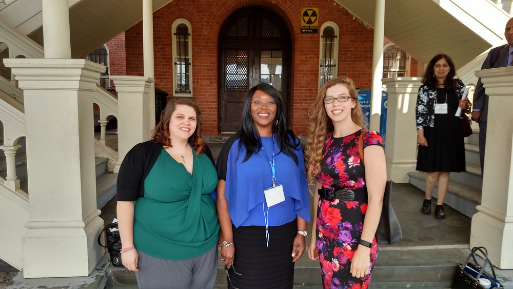 Professor Musah with Justine and Kristen outside MARM 2016.