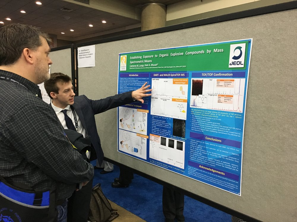 Cameron presenting his poster.