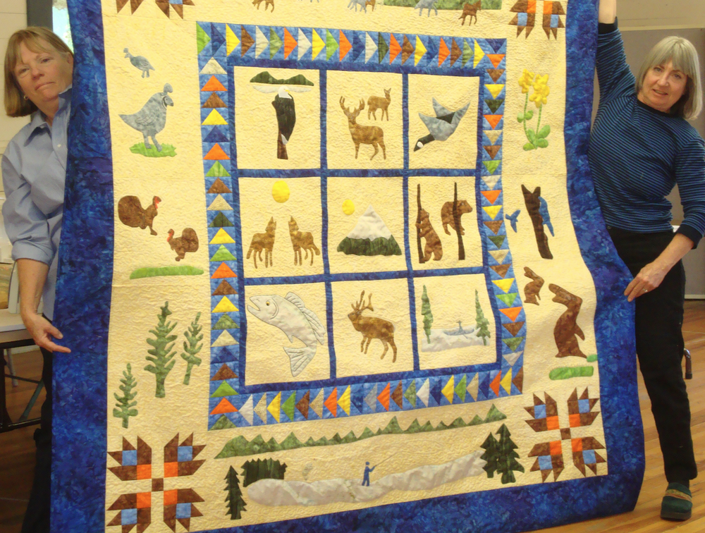2013 Opportunity Quilt designed by Kaye Burns (right). Hand appliqued by members.