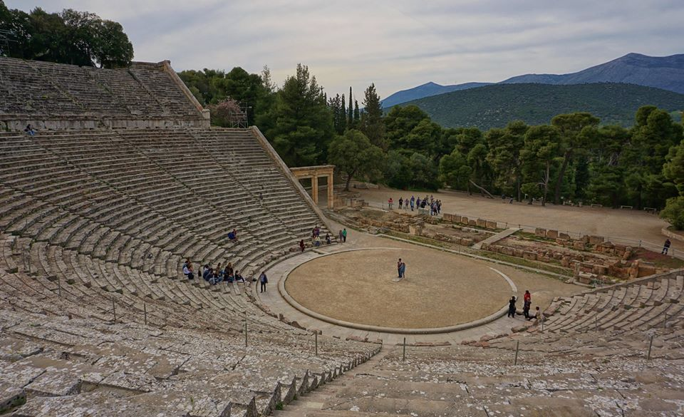The Great Theatre of Epidaurus dates back to the 4th century BC and still holds a commanding position on the Peloponnese peninsula. The acoustics are superb, as even where I took this photograph, I could hear the people in the center with no problem. — at Ancient Theatre of Epidaurus