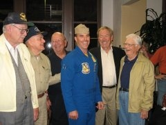 With the Twilight Warriors At the reunion of the pilots of Intrepid's Corsair squadron from the Battle of Okinawa.  The kid in the flight suit is a Blue Angel