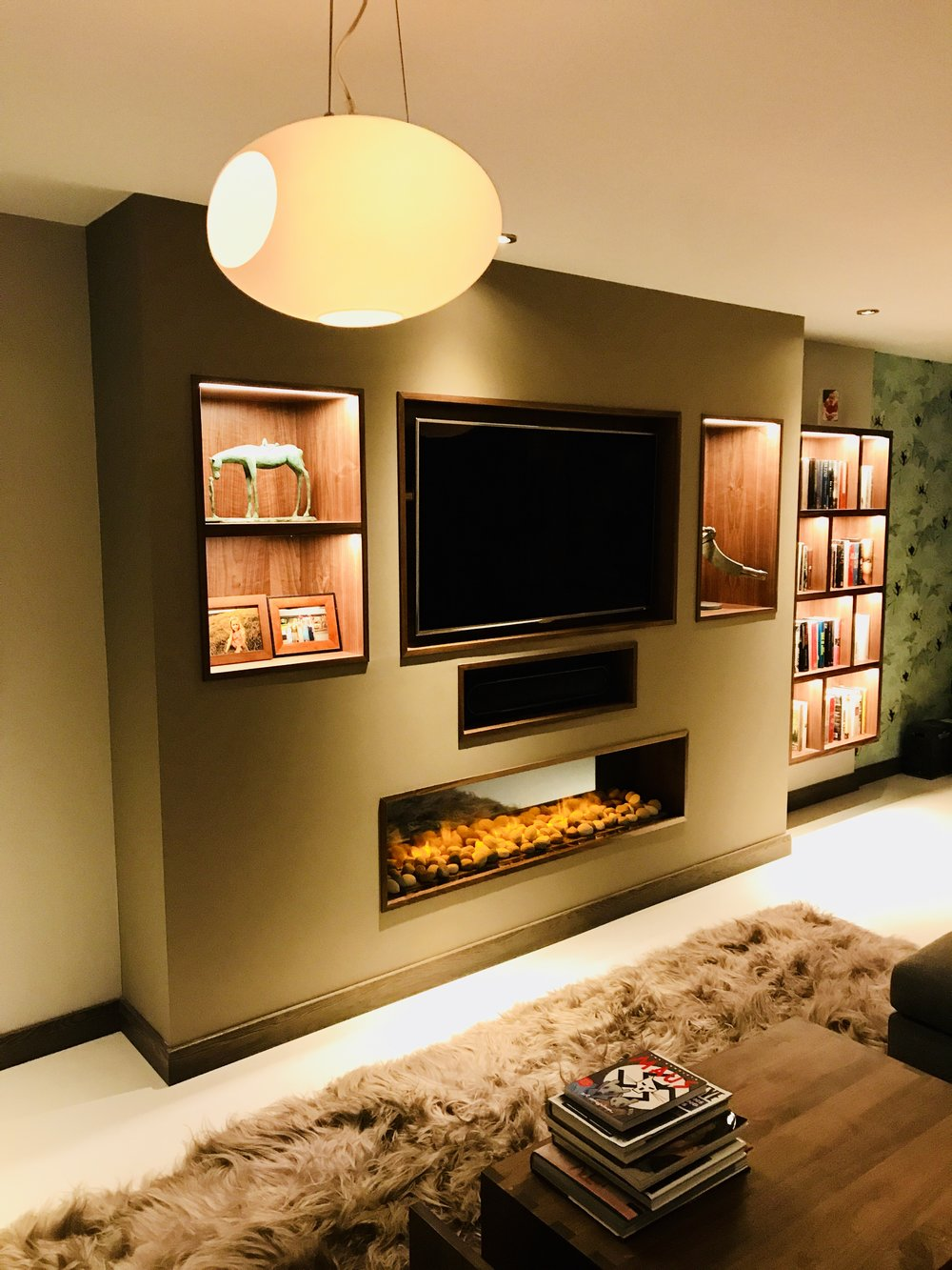 TV and fireplace joinery with wall hung book case