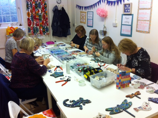 Mosaic making in action.  There are so many lovely tiles to choose from!