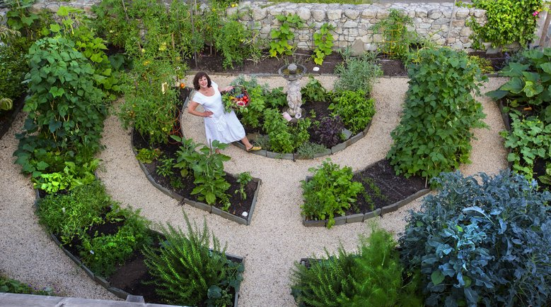Vegetable_garden_arcs_gravel_raised_stone_edged.jpg