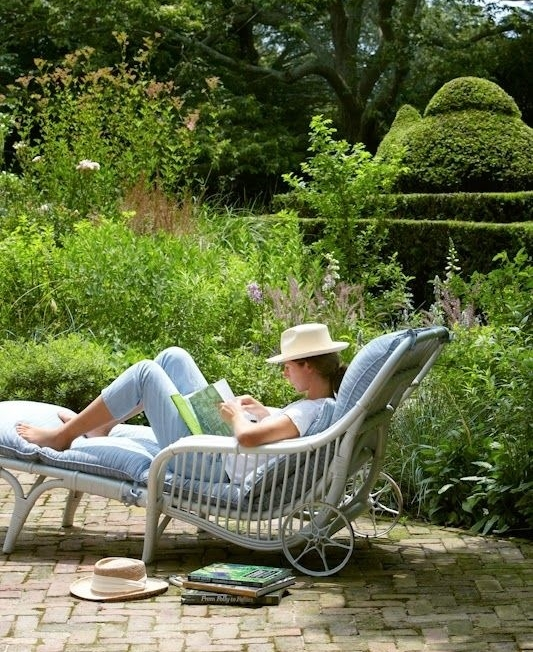 Garden Woman reading in chaise topiary perennials.jpg
