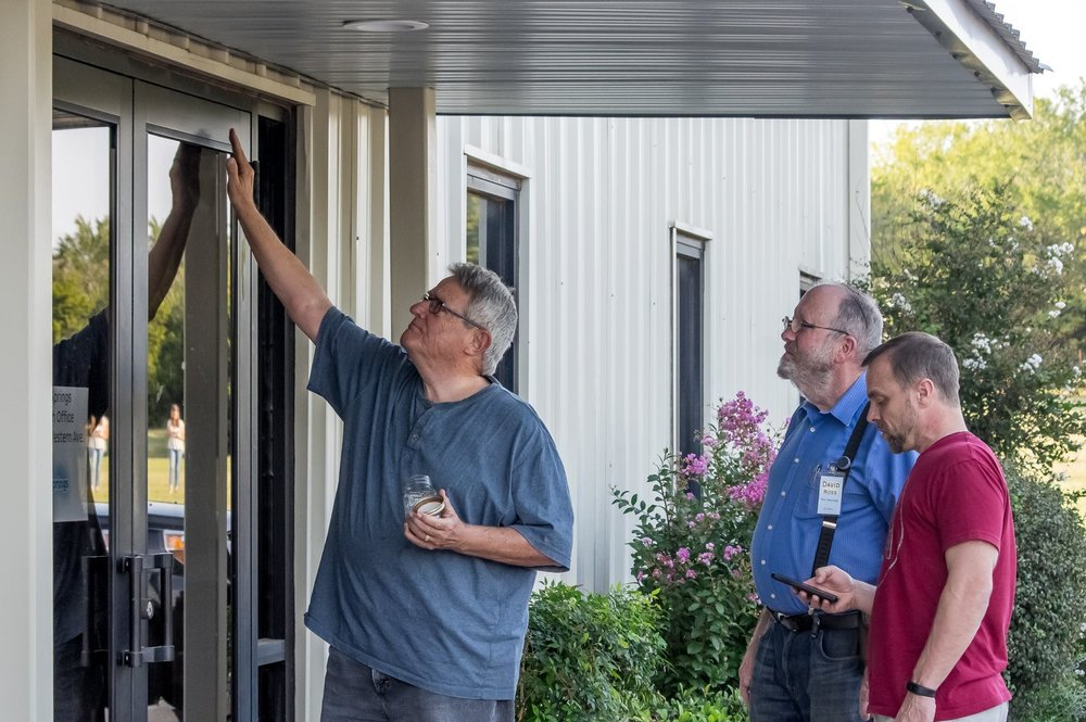 Anointing of the new building by elders Monte Stephens, David Ross, and Jim Dvorak.                      Photo Cred: Rod Cuellar