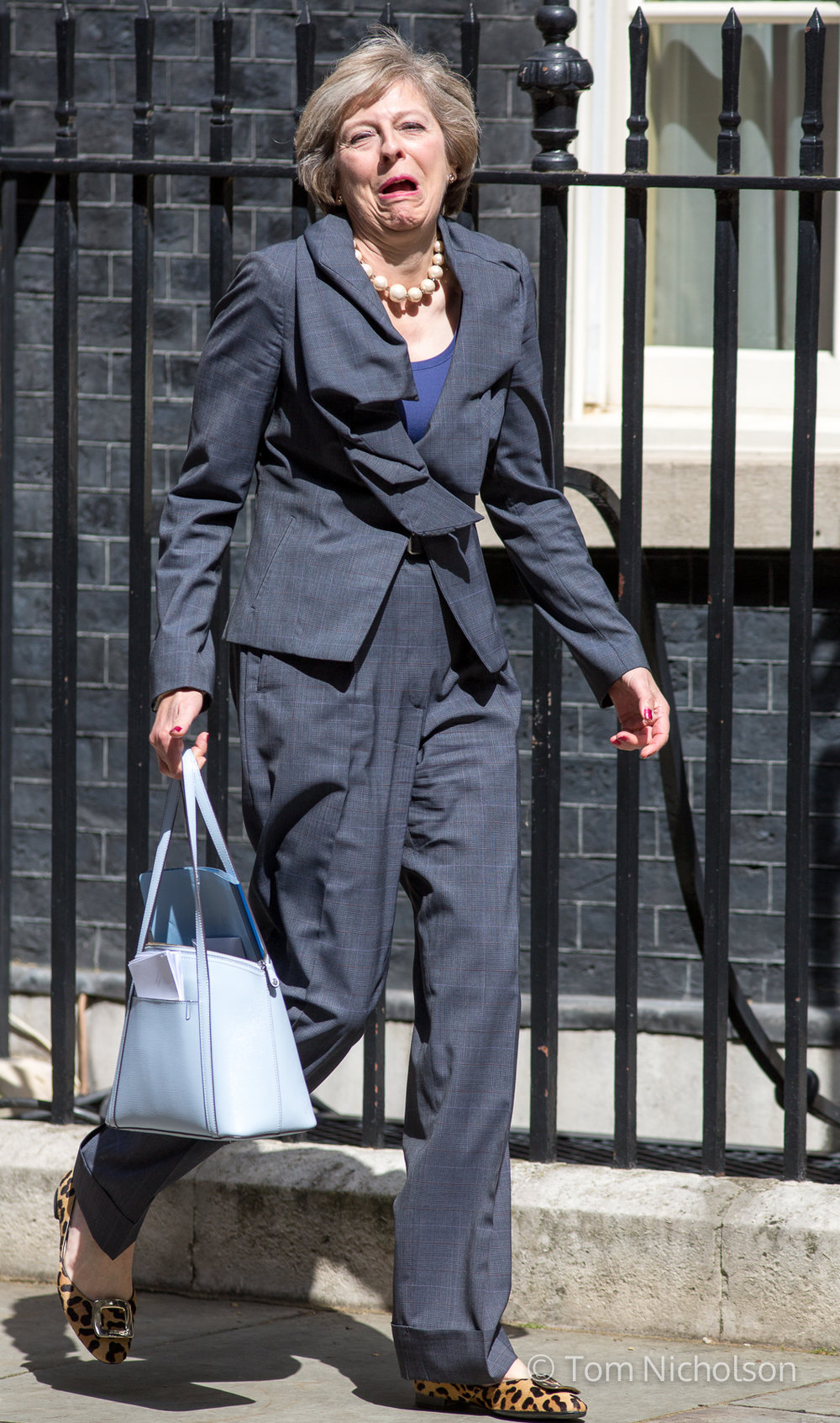 12/07/2016. London, UK. British Prime Minister in waiting and new leader of the Conservative Party Theresa May pulls a face after turning the wrong way out of 10 Downing Street.