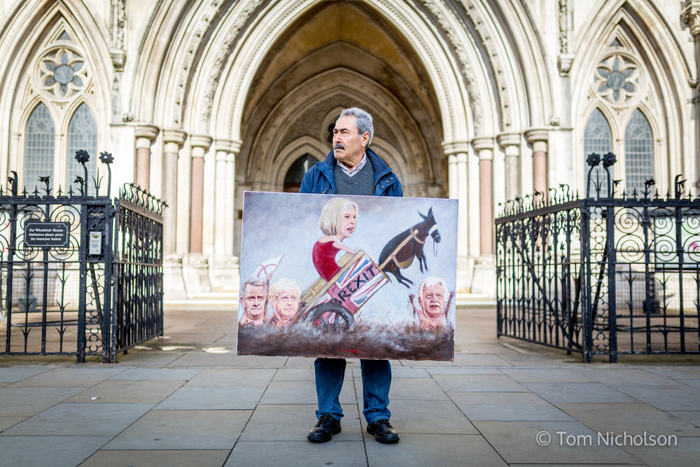17/10/2016. London, UK. Satirical artist Kaya Mar poses with his artwork outside the High Court, London, on the day a legal challenge against Brexit begins, lead by campaigner Gina Miller.