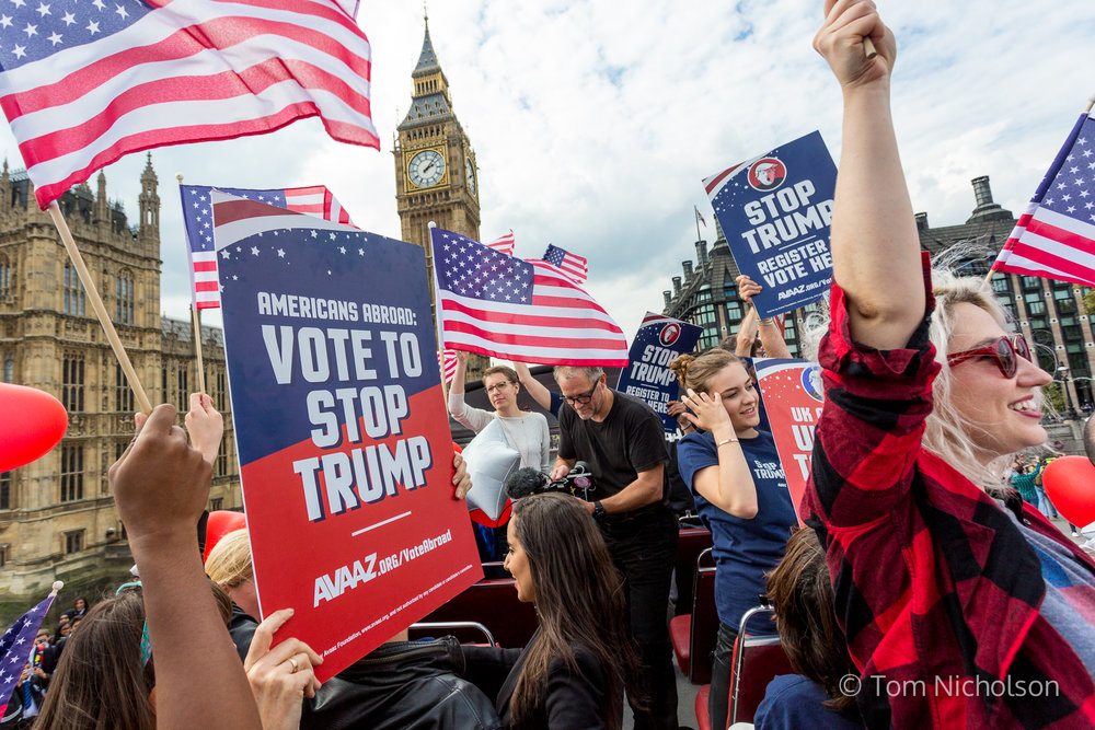21/09/2016. London, UK. Campaign group Avaaz organise a 'Stop Trump' campaign bus to tour central London, rallying US expats to register to vote.