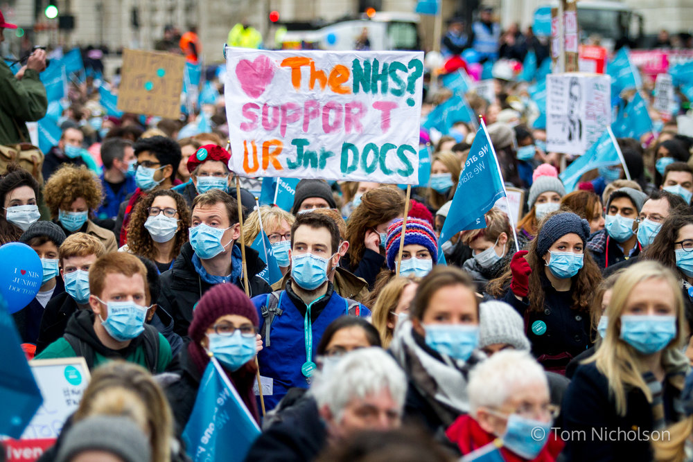 06/02/2016, London, UK. Junior Doctors host a masked march outside Downing Street, to demonstrate against work and pay conditions.