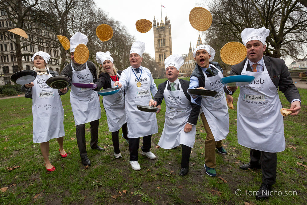 09/02/2016. London, UK. The MP-team flip pancakes as part of The Rehab Parliamentary Pancake Race. The annual event takes place between MPs, Lords and members of the Parliamentary Press Gallery.
