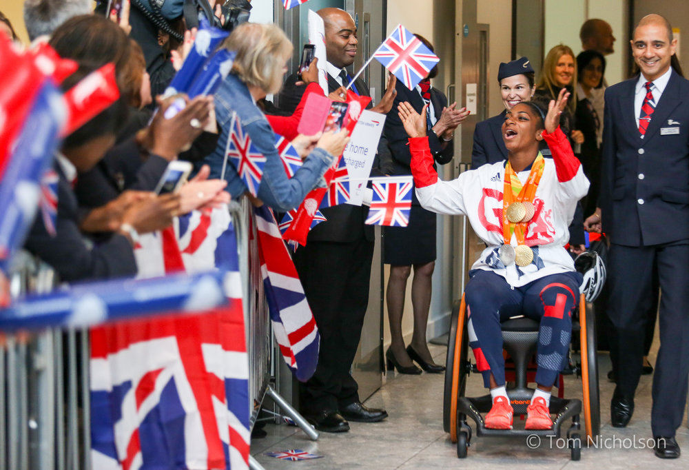 20/09/2016. London, UK. Team GB Paralympian Kadeena Cox arrives at terminal 5 of London Heathrow Airport after flying on British Airways flight BA2016. Cox carried the GB flag at the closing ceremony after becoming the first Briton in 28 years to win medals in two sports (track cycling and athletics) at the same Paralympics. Team GB finished second in the Paralympics medals table with 147 medals beating their total of 120 at London 2012.