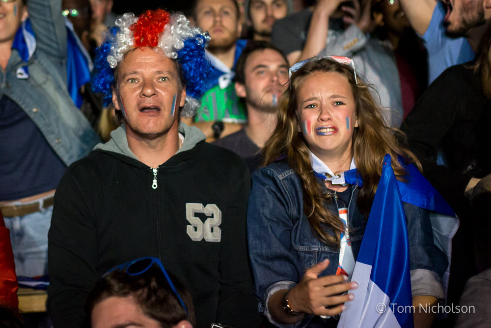 10/07/2016. London, UK. A french daughter and father look in disbelief as Portugal beat France 1-0 in extra time at the UEFA Euro 2016 Final.