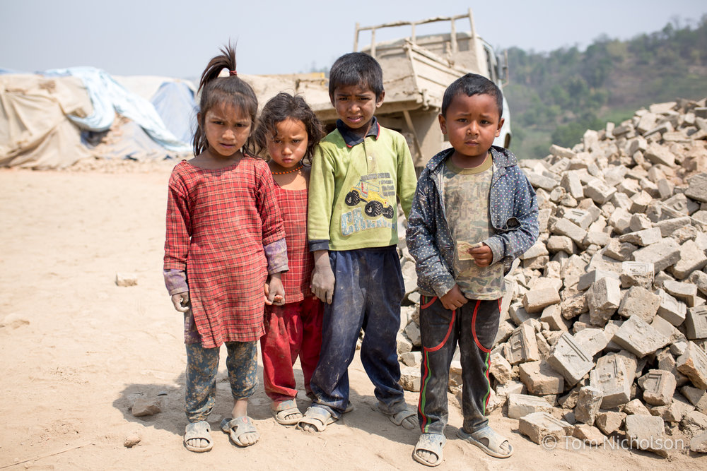 Children in the UK brickworks factory in Bungamati, Kathmandu, Nepal on 15 March 2016. Around 400 labourers, including children, work in very dusty and hot conditions.