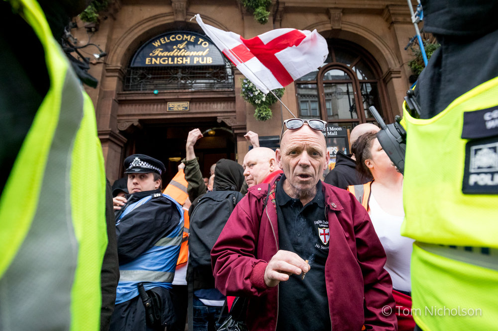 ©2017 Tom Nicholson. 01/04/2017. London, UK. Far-right demonstrators march in London following the terror attack in Westminster by Khalid Masood. A counter demonstration is taking place organised Unite Against Fascism (UAF) is taking place at the same time. Far-right groups such as the English Defence League, the South East Alliance and Britain First take part in the demonstration.
