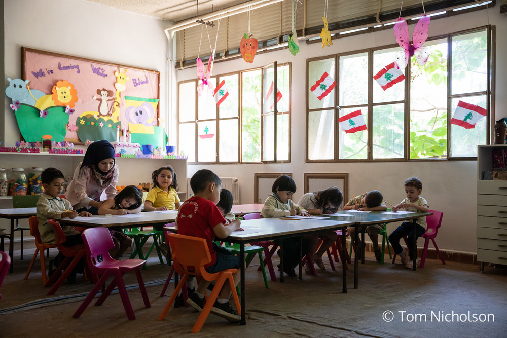 "©2018 Tom Nicholson. 20/06/2018. Beirut, Lebanon. Rasha Rafai, age 23, from Syria, is a school teacher in Bekaa, Lebanon. After leaving Syria due to the war, she couldn't afford to continue her education and was not able to work due to residency permits. Rasha then studied a Childhood Education course after receiving a SPARK scholarship, but could not find a job as a teacher, she believed due to her nationality. After this, the institute where she studied offered her a job offered her a job as a school teacher. Rasha says: ""For me, education is everything. It is the key to a new life."" She hopes to return to Syria, to teach the children and use her new skills."