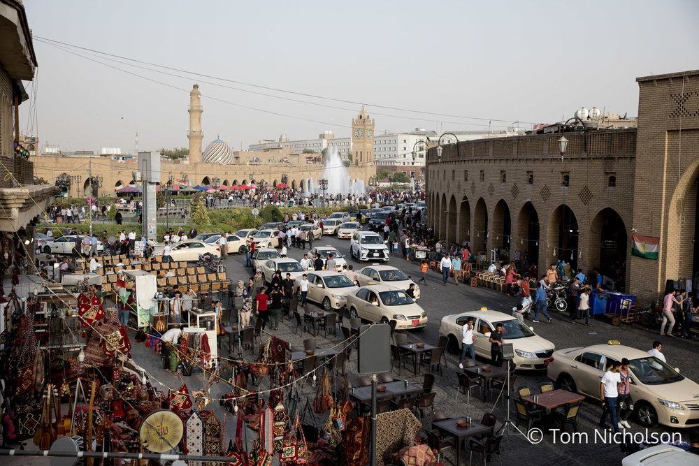 ©2018 Tom Nicholson. 29/06/2018. Erbil, Iraq. People gather around Erbil Citadel and Bazaar after Friday prayers, on a summer's evening with temperatures around 42 degrees.