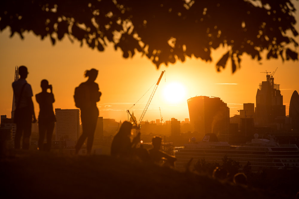 The sun sets over London's skyline, as the UK experiences the hottest day of the year so far. The Met Office reported temperatures reached 33.3 degrees celsius in Santon Downham in Suffolk today. July 2018 - London, UK.