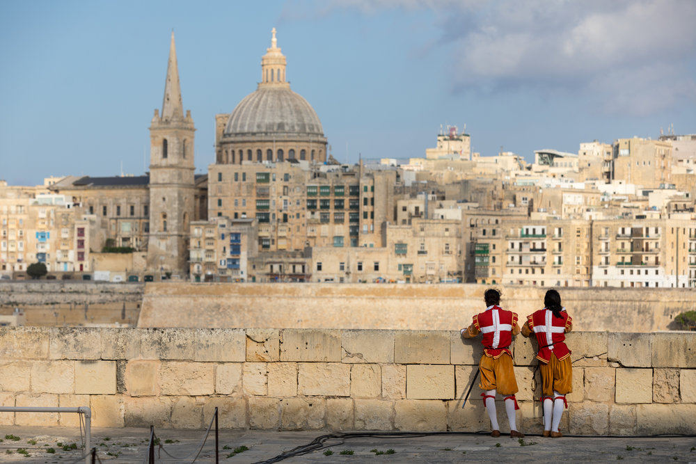 Performers take a break during a private party on Manoel Island. June 2018 - Valletta, Malta.